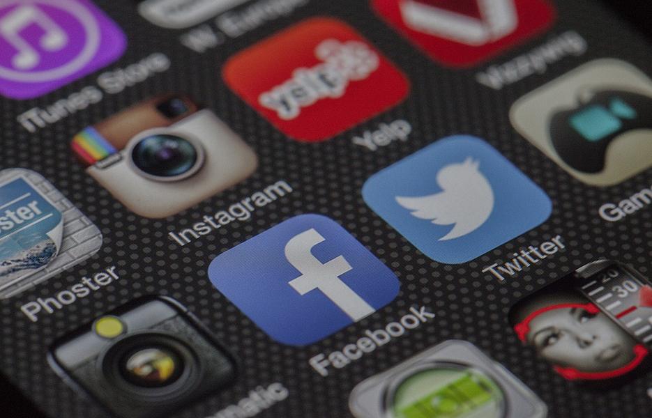 Social media app logos on smartphone