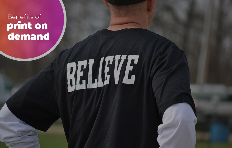 man with t-shirt printed with the word 'Believe' printed on the back